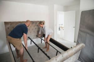 couple working on bed frame